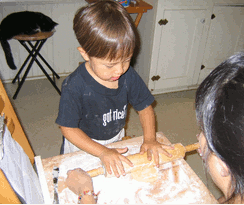 Art Baird's son, at age three, making pie crust from scratch.